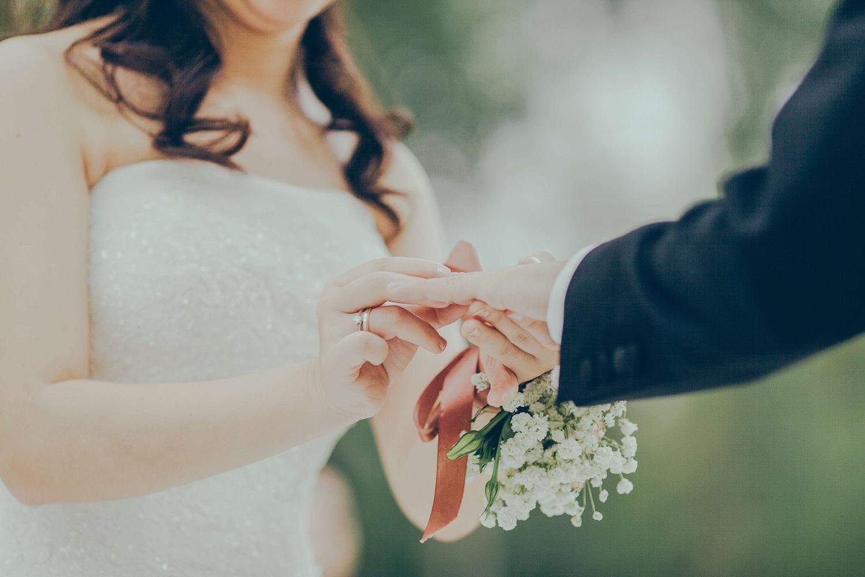 Woman Giving Wedding Ring to Man