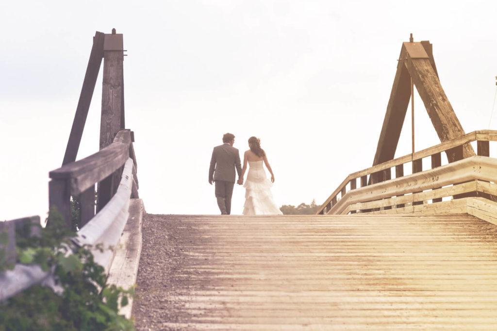 Wedding Couple Walking on the Bridge